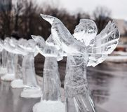 Carved sculpture of frozen angel in ice Royalty Free Stock Image