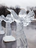 Carved sculpture of frozen angel in ice Stock Image