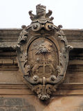 Carved Shield. During the time of the Maltese Knights Hospitaller  the old capital of Mdina was primarily occupied by the Maltese nobility who built many grand Stock Image