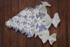 Carved shoal of fish. Wall mounted carving of a shoal of blue fish on a wooden wall at rushcliffe country park Nottinghamshire england Stock Photos