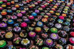 Carved soap flower balls - Thailand. Hand carved and watercolor painted scented soap souvenir balls in a market in Thailand Stock Image