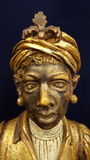 Carved statue. Polychrome decorative slave negro Stock Images