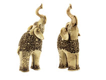 Carved statuettes of indian elephants. Two carved statuettes of indian elephants  with beautiful ornate pattern. One elephant looks almost in front, another Royalty Free Stock Image