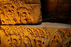Carved stone. Rich colors of carved stone in the banteay srey temple cambodia Stock Image