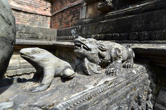 Carved stone animals on a public fountain. Kathmandu, Nepal Stock Image
