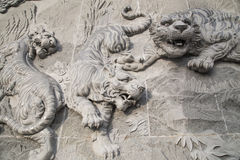 The carved stone of Chinese temple  and Tiger statue Stock Photo