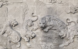 The carved stone of Chinese temple and Tiger statue royalty free stock image