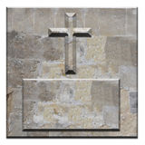 Carved stone cross on square bevelled panel Stock Photo