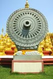 Carved stone Dhammajak Stock Photography