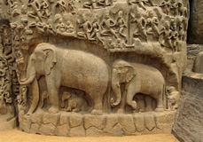Carved in stone elephants and Indians Royalty Free Stock Image