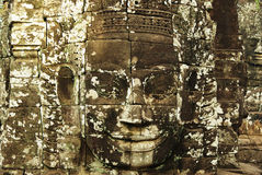 Carved stone faces at ancient temple in Angkor Wat. Heroic stone carved womens faces at ancient Angkorian temple in Angkor Wat, Cambodia. A buddhist and hindu Stock Images