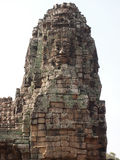 Carved stone faces at temple in Angkor Wat Stock Photo