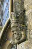Carved Stone Figure Head. On Window surround. St. Marys Norman Church, Beverston, Gloucestershire Stock Image