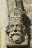Carved Stone Figure Head. On Window surround. St. Marys Norman Church, Beverston, Gloucestershire Stock Photography