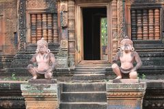 Carved stone guardian statues in Banteay Srei, Cambodia Royalty Free Stock Images