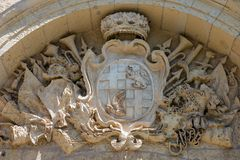 Carved stone hatchment. In Mdina, Malta Royalty Free Stock Photo