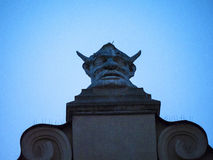 Carved stone Head on top of the Cloth Hall in Krakow Poland Royalty Free Stock Photography