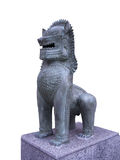 Carved stone lion. Stone lion stands guarding on granite base Stock Image