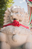 Carved stone lions standing in a Chinese temple. Carved stone lions standing in a Chinese temple Royalty Free Stock Images
