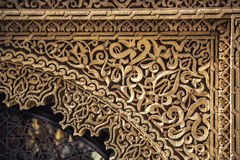 Carved stone pattern. Herbal arabesque from carved stone Royalty Free Stock Photography
