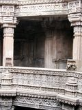 Carved stone pillars. Carved ancient stone found in ahmedabad - adalaj Royalty Free Stock Photo