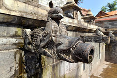 Carved stone public fountain. Pashupatinath, Nepal Royalty Free Stock Photography
