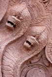 Carved stone serpents Stock Photos