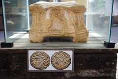 1st Century Synagogue stone at Magdala-2. This carved stone shows, among other elements, a replica of the menorah that was situated in the Temple in Jerusalem royalty free stock photo