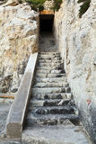 Carved stone staircase to doorway. Carved stone staircase to cave entrance stock photography