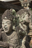 Carved stone statues of human form at Bali Museum Denpasar. Royalty Free Stock Photography