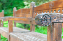 Carved sun symbol on the bench Stock Photo