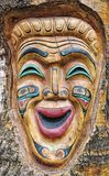 Carved theater mask. A carved theater mask that has a happy face Stock Photography