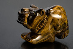 Carved tiger-eye tiger Stock Photography