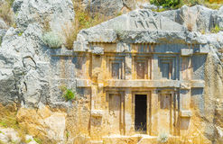 The carved tomb. The ancient lycian carved tombs in Myra nowadays become a very popular landmark of Turkey Stock Photo