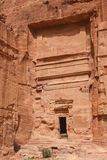 Carved tomb in the ruins of the ancient Nabatean city of Petra Stock Photography