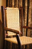 Carved tree wicker chair Royalty Free Stock Image