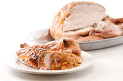Carved turkey dinner. Holiday turkey dinner carved for serving to guests Stock Photos