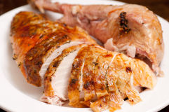Carved turkey dinner. Holiday turkey dinner carved for serving to guests Stock Image