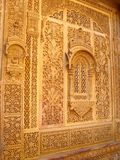 Carved Wall. A beautifully carved wall with artistic designs at the Jaisalmer fort / palace, India Stock Photography