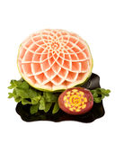 Carved watermelon and mango on a plate Stock Images