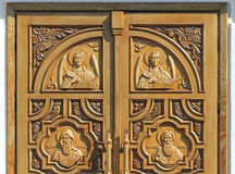Carved well decorated door in orthodox church Royalty Free Stock Images