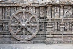 Carved Wheel on Konark Temple. Ornately carved stone wheel on the ancient Surya Hindu Temple at Konark, Orissa, India. 13th Century AD Stock Photo