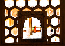 Carved Window. Architecture inside an old historic palace in india with great natural lighting Stock Photos