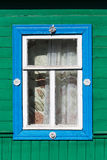 Carved window in old National russian wooden  house Stock Photo