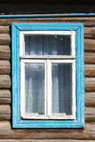 Carved window in old National russian wooden  house Royalty Free Stock Images