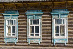 Carved window in old russian wooden country house Stock Images