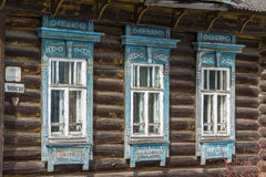 Carved window in old russian wooden country house Royalty Free Stock Photos
