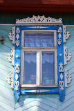 Carved window of a russian wooden house. The elaborate carved window of a rural russian wooden house also known as isba Stock Photography