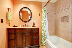 Carved wood bathroom vanity cabinet with mirror Royalty Free Stock Photos