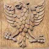 Carved Wood Eagle. Carved Wood Relief of an Eagle Royalty Free Stock Photography